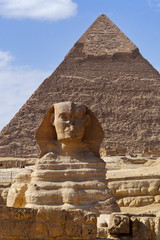 Giza City, Giza / Egypt - January 2015: The Great Sphinx with the Pyramid of Khafre in the background at Giza Plateau