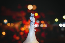 Cake Top Decorated With Porcelain Bride And Groom.