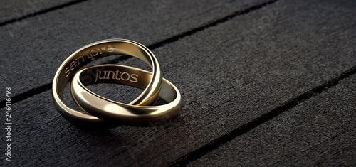 Fényképezés Dos anillos de boda entrelazados con frase siempre juntos en español