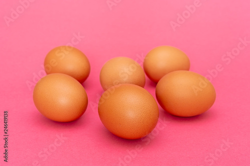 Six brown eggs