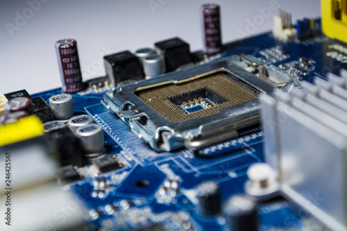 The old and dusty motherboard from the computer  Blue color