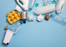 Top View Of Rubbish For Recycling On A Blue Background