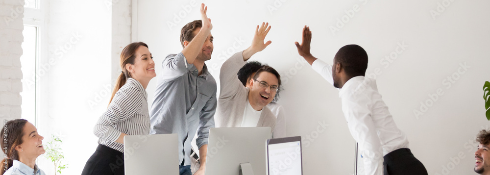 Fototapety, obrazy: Happy diverse workmates giving high five celebrating corporate success feels excited in workplace, succeed common goal career growth concept, banner for website header design with copy space for text