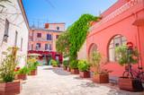 Fototapeta Uliczki - Traditional cozy greek street in city Nafplio, Greece
