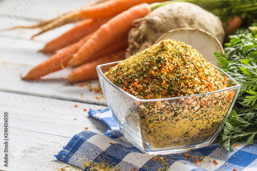 Photo  Seasoning spices condiment vegeta from dehydrated carrot parsley celery parsnips