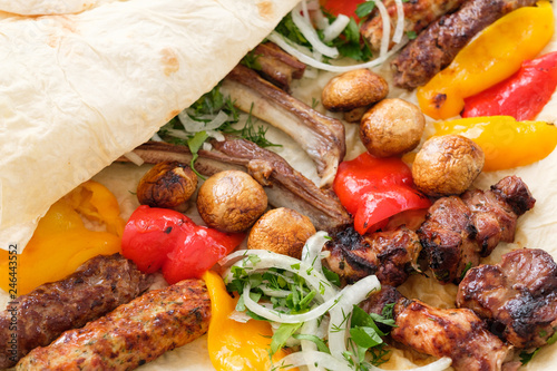 Aluminium Prints Grill / Barbecue Tasty restaurant meal composition. Fried foodstuff with crispy wheaten flatbread.