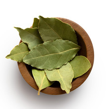 Dried Bay Leaves In A Dark Wood Bowl Isolated On White From Above.