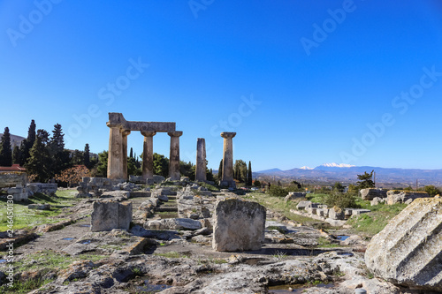 Fotografie, Obraz  Corinth Greece - Ancient pillars viewed with rubble from ruins in foreground and