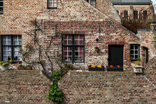 The Detail Of The Brick Houses In Bruges In Belgium. The Typical Colorful Facades On Historic Houses.