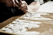 Craftsman Hands Using A Gouge ...