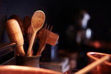 Wooden Kitchen Tools In Rustic Container