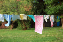 Clothes Hanging And Dressed To Dry Outdoors On The Clothesline