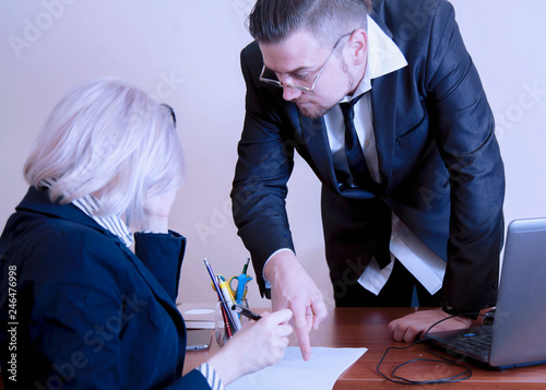 Fototapeta Business people having a team meeting. Boss businessman pointing to a document where his employee is about to sign. obraz