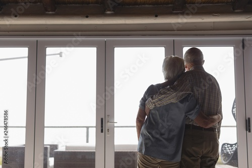 Senior couple standing together at home Wallpaper Mural