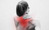 Young woman having pain in the back and neck. Health-care Concept. - 246481390