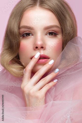 Beautiful girl with light make-up and gentle manicure in pink clothes. Beauty face. Design nails. Wall mural