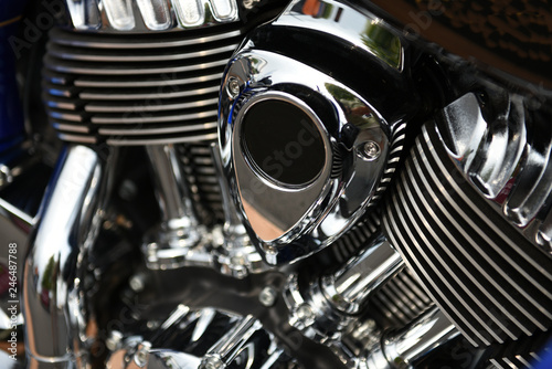 Valokuva  Close up of a shiny chrome motorcycle engine assembly with isolated focus
