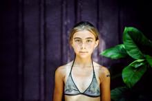 Portrait Of Girl In Bikini Top Standing Outdoors