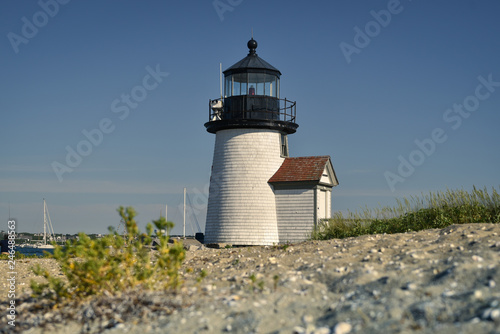 Fotografie, Obraz  Old historic lighthouse on a beach in Nantucket New England