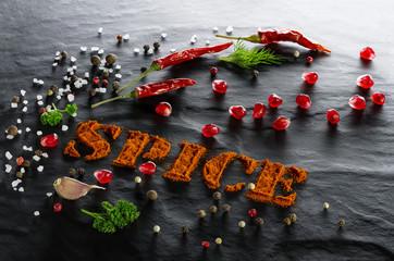 Fototapeta Przyprawy Spice. Ground paprika, chili pepper, garlic, parsley, urop, assorted peppers, pomegranate and sea salt close up
