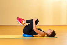 Sports Woman Doing Therapeutic Exercises In Indoor Gym