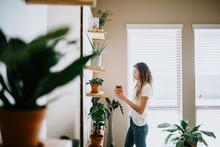 Woman With Her Indoor Plants