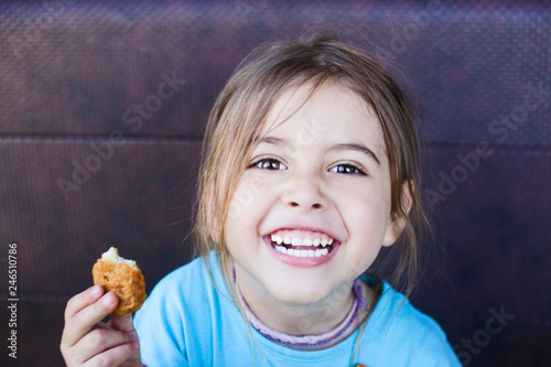 Happy child with Nuggets