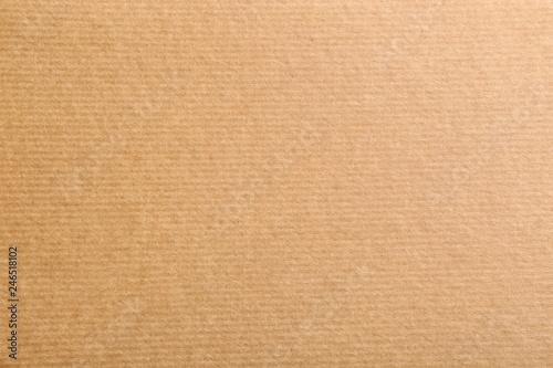 Sheet of kraft paper as background, top view. Recycling concept Billede på lærred
