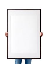 Holding Frame Mockup. Photo Mockup. The Man Hold Frame. For Frames And Posters Design. Frame Size 24x36 (61x91cm).