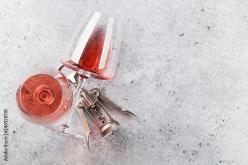 Rose wine glasses and corkscrew