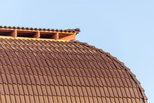 The Domed Roof Of The House Is Covered With Tiles. Dark Brown Tile. Building. House Built Of Brick. Metal Tile. Roof Of The House. Exterior Of The House. Roof Structure.