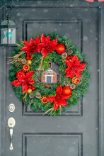 Dark Front Door With Red And Gold Christmas Wreath