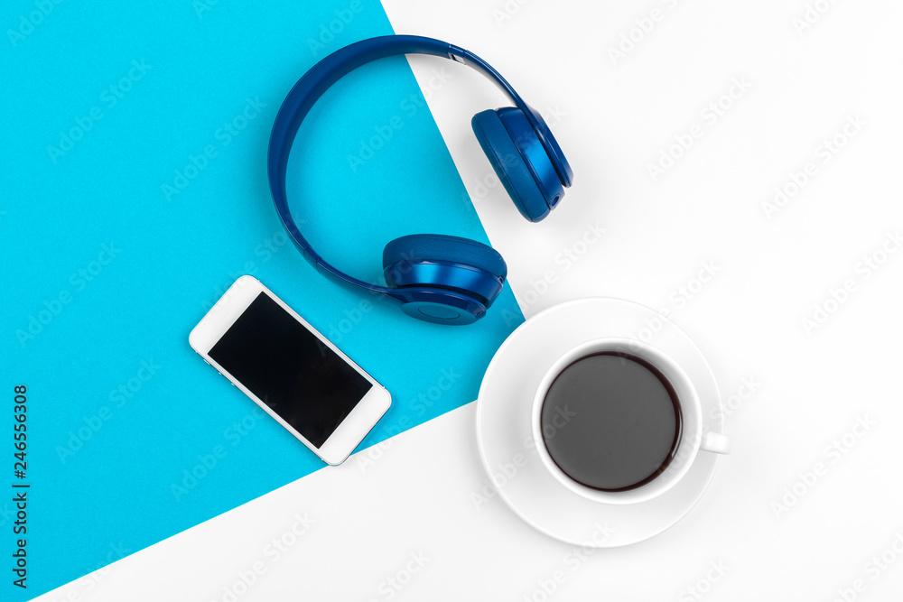Fototapeta Blue headphones on blue and white color background - obraz na płótnie