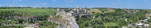 Foto auf Leinwand Olivgrun Panorama with Castle in Kamianets-Podilskyi, Ukraine. This is a former Ruthenian-Lithuanian castle and a later Polish fortress. It was first mentioned in the 14th century.