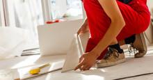 Worker Hands Placing Spacers Between Ceramic Floor Tiles - Close Up