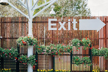 Wooden Wall With Exit Sign