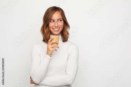 portrait of happy young woman with to go cup of coffee - 246566131