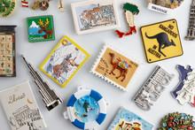 Magnet Souvenirs On White Refrigerator