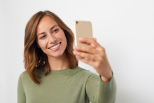 Young Smiling Woman Taking A Selfie
