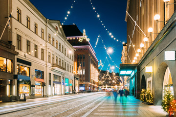 Helsinki, Finland. Night View Of Aleksanterinkatu Street With Railroad In Kluuvi District In Evening Christmas Xmas New Year Festive Illumination