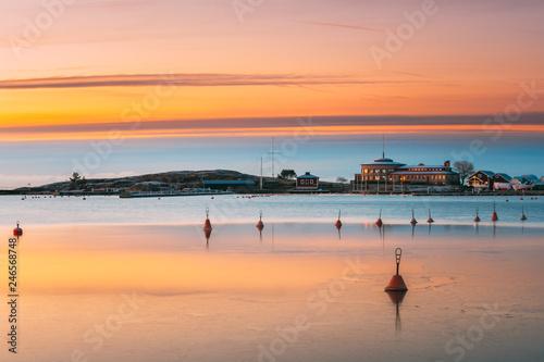 Foto auf Leinwand Skandinavien Helsinki, Finland. Landscape With Liuskasaari Pier, Jetty At Winter Sunrise Time. Tranquil Sea Water Surface At Early Morning Near Liuskasaari