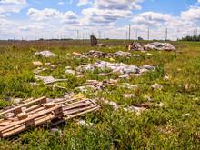 Garbage Dump In Green Field