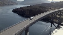 Aerial Footage Of A Vintage Campervan Driving Across Kylesku Bridge On A Sunny Day In Sutherland, Assynt, Scottish Highlands, Scotland