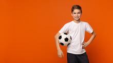 Boy Posing With Soccer Ball On Orange Studio Background