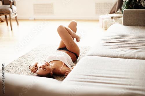 Deurstickers Ontspanning Cute brunette girl posing at home loft studio