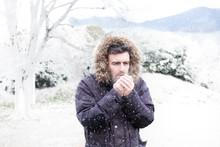 Man In Cold And Snowy Weather ...