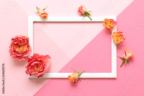 Happy Mother's Day, Women's Day, Valentine's Day or Birthday Pink Pastel Colored Background. Flat lay mock up greeting card with beautiful coral hue roses.