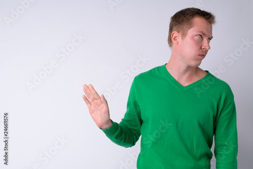 Portrait of annoyed young man showing stop gesture Canvas Print
