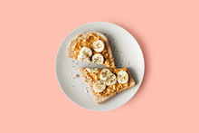 Peanut Butter Chia Seed Banana Toast For Breakfast On A Pink Background, Healthy Snack, Top View