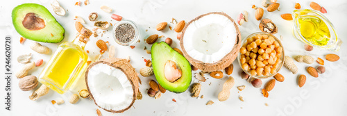 Healthy vegan fat food sources, omega3, omega6 ingredients - almond, pecan, hazelnuts, walnuts, olive oil, chia seeds, avocado, coconut,  banner copy space - 246620728